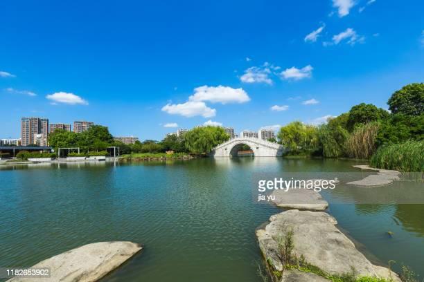 park natural scenery with a stone bridge over - 江陰市 ストックフォトと画像