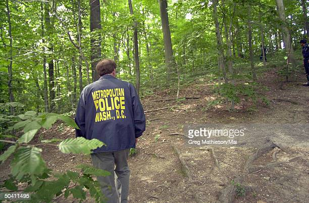 Park police and fire fighters searching wooded area of park for evidence leading to whereabouts of missing Washington intern Chandra Levy.