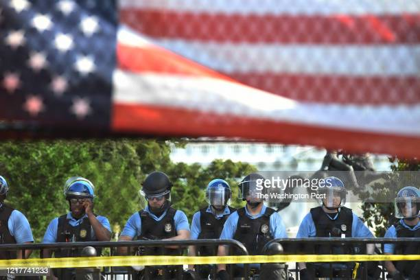 S Park Police are seen in Lafayette Square as demonstrators gather outside a fence near the White House over the death of George Floyd on Tuesday...