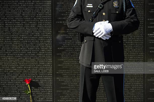 Park Police Honor Guard member stands during a Veterans Day ceremony at the Vietnam Veterans Memorial on the National Mall in Washington DC November...