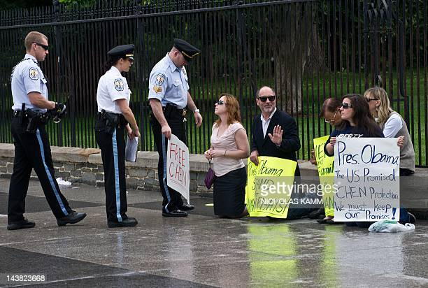 Park Police move in to arrest protesters demanding the release of Chinese activist Chen Guangcheng in front of the White House in Washington on May...