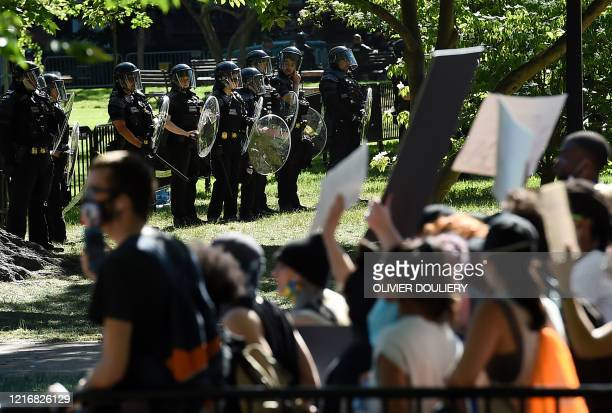 US Park Police stand watch inside Lafayette Square near the White House in Washington DC on June 1 2020 as demonstrators protest the death of George...