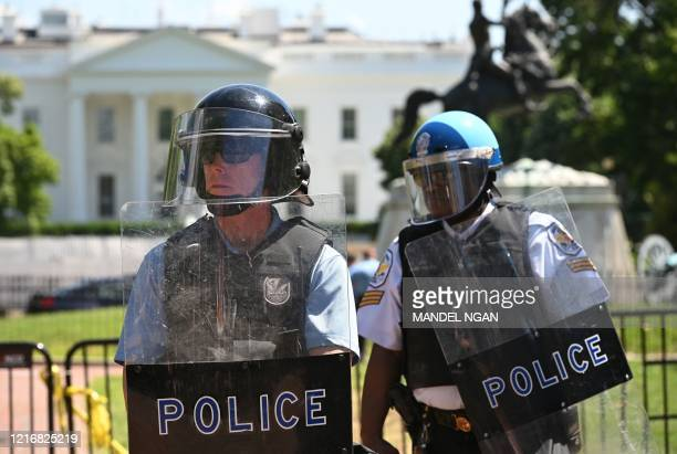 US Park Police stands watch inside Lafayette Square near the White House in Washington DC on June 1 2020 Police fired tear gas outside the White...
