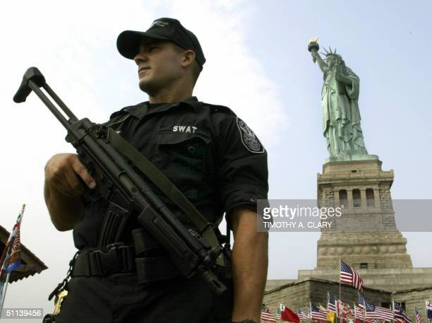 Park Police SWAT Team officer Michael Fermaint stands guard in front of the Statue of Liberty on Liberty Island 03 August 2004The Statue's pedestal...