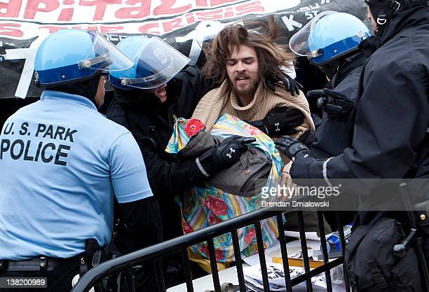 Park Police take a member of Occupy DC into custody when he refused to leave a library tent while a section of McPherson Square was closed February 4...