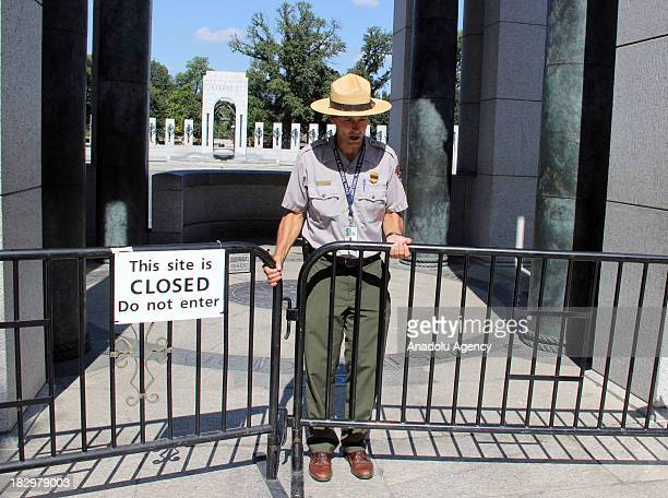 S Park Ranger closing down the barricades of the WWII Memorial on the second day of the federal government shutdown October 2 2013 in Washingon DC A...