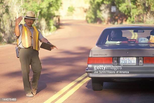A park ranger directing motorists Zion National Park UT