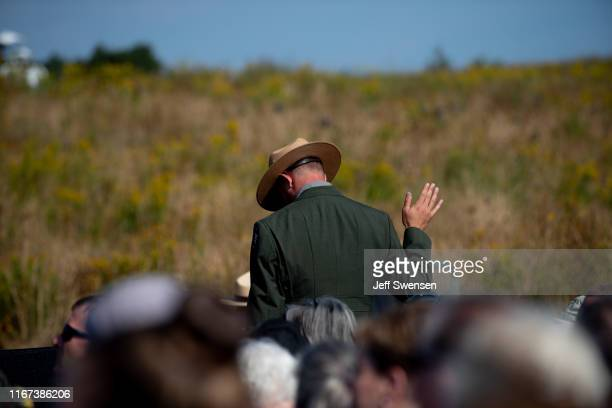 S Park Ranger signals to the bell ringers calling out the victims' names before US Vice President Mike Pence delivers a speech at Flight 93 National...