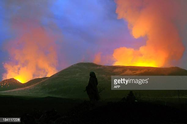 A park ranger stands at the site of a new eruption in Virunga National Park near Goma on November 24 2011 Almost three weeks after a fissure opened...