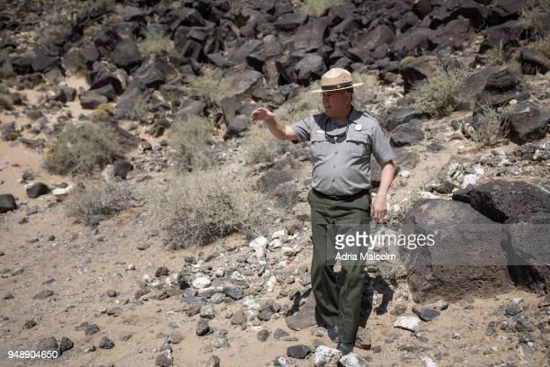 Park Ranger Superintendent Dennis A Vasquez guides a tour at Petroglyph National Monument on April 19 2018 in Albuquerque New Mexico