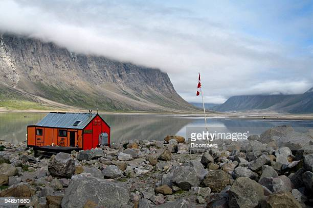 A park ranger's hut and the Canadian flag sit on the edge of Pangnirtung Fjord Nunavut Canada on Aug 19 2007While comfortable Caribbean cruises still...