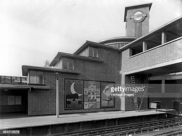 Park Royal Underground Station Western Avenue Ealing London c1936 Posters advertise sleeper services to Paris and the North of England Park Royal...