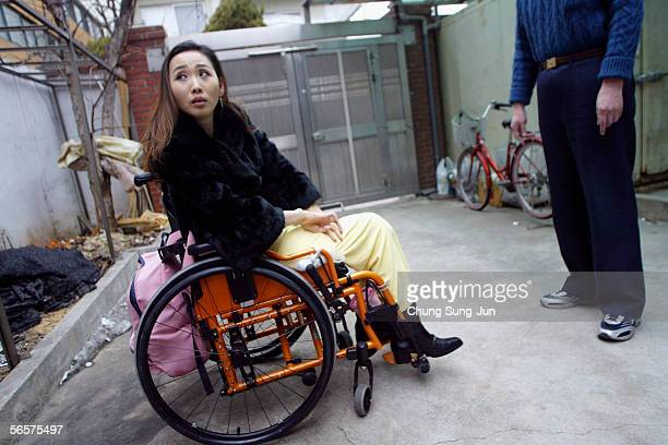 Park Sang-Hee, who is spinal cord injury patient, sits in her wheel chair on January 12, 2006 in Seoul, South Korea. More than 130,000 spinal cord...