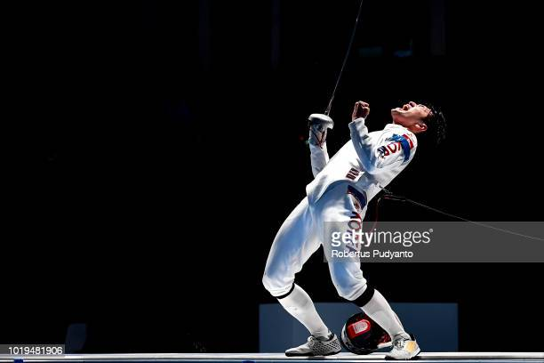 Park Sangyoung of Korea celebrates victory after beating Kano Koki of Japan during Men's Epee Individuals Semifinal match on day one of the Asian...