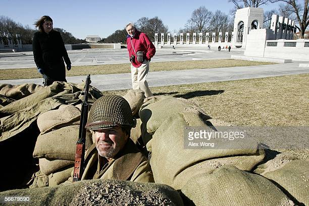S Park Service park ranger Mark Reagan sits in a replica of a foxhole as he participates in a living history program to commemorate the 61st...