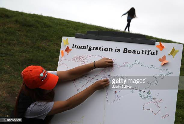 Park Service worker puts pins on a map of the world during a naturalization ceremony for kids between the ages of 612 at Crissy Field near the Golden...