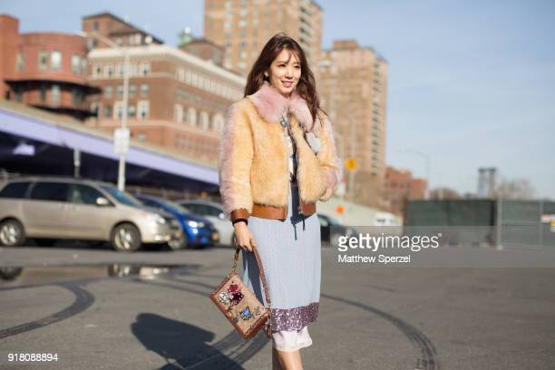 Park ShinHye is seen on the street attending Coach 1941 during New York Fashion Week wearing Coach on February 13 2018 in New York City