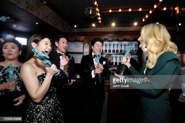 Park Sodam Lee Sun Kyun Song Kang Ho winners of Outstanding Performance by a Cast in a Motion Picture for 'Parasite' pose with Laura Dern winner of...