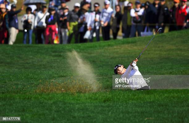 Park SungHyun of South Korea blasts out of a bunker at the 6th hole during the final round of the LPGA KEB Hana Bank Championship at Sky72 Golf Club...