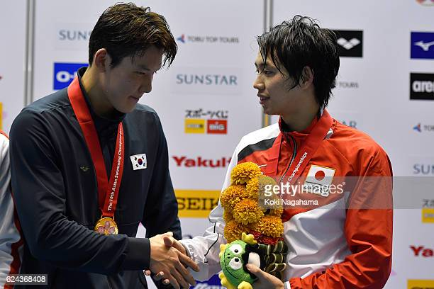 Park Taehwan of South Korea shake hans with Shogo Takeda of Japan after the Men's 1500m Freestyle final during the 10th Asian Swimming Championships...