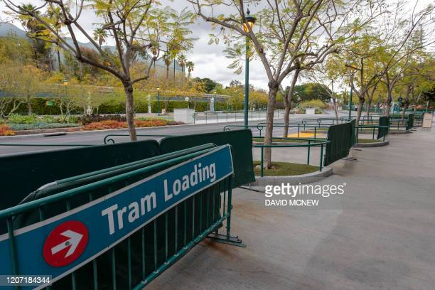 A park tram loading area stands vacant on the first day of the closure of Disneyland and Disney California Adventure theme parks as fear of the...