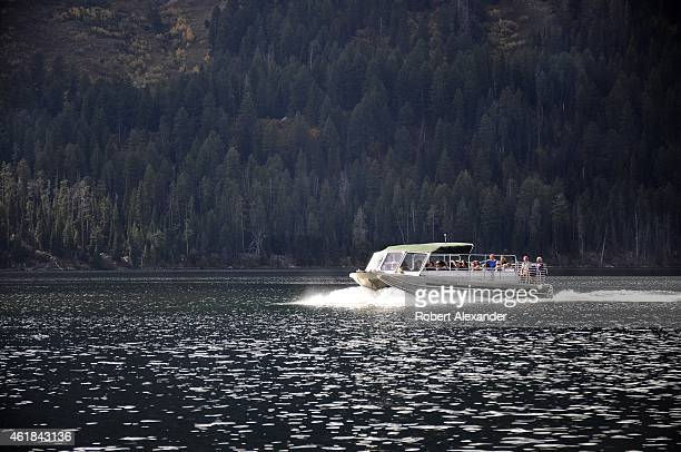 Park visitors enjoy an excursion boat ride on Jenny Lake in Grand Teton National Park in Wyoming