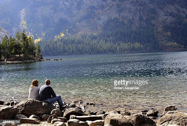 Park visitors enjoy the view of Jenny Lake in Grand Teton National Park in Wyoming