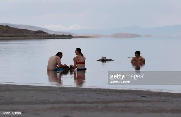 Park visitors wade in the waters of the Great Salt Lake at Antelope Island on August 01, 2021 near Syracuse, Utah. As severe drought continues to...