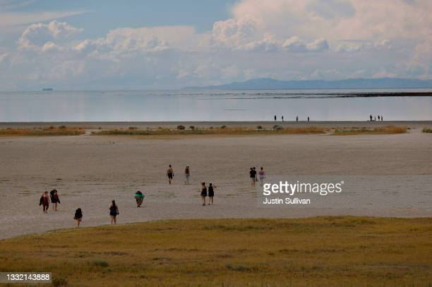 Park visitors walk on an area of the Great Salt Lake that used to be underwater at Antelope Island on August 01, 2021 near Syracuse, Utah. As severe...
