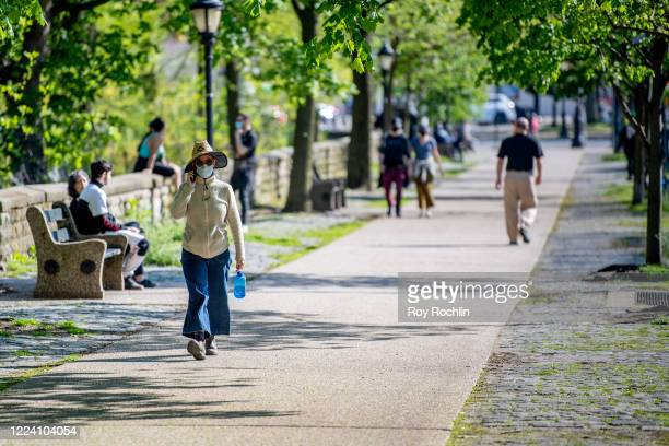 Park visitors wear masks at Prospect Park in Brooklyn during the COVID-19 outbreak on May 10, 2020 in New York City. COVID-19 has spread to most...