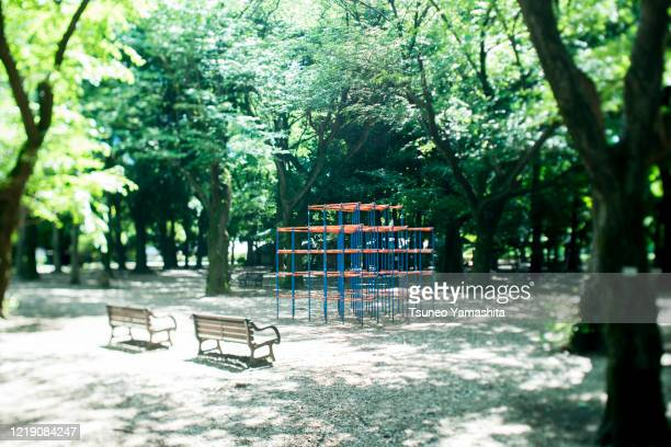 park with playground equipment - leisure equipment stock pictures, royalty-free photos & images