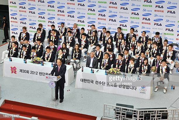 Park YongSung president of the Korean Olympic Committee speaks during a ceremony for the athletic delegation at Incheon airport west of Seoul on...