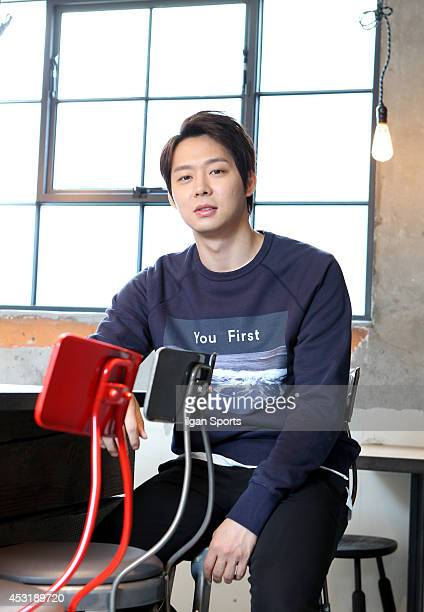 Park YooChun of JYJ poses for photographs on July 30 2014 in Seoul South Korea