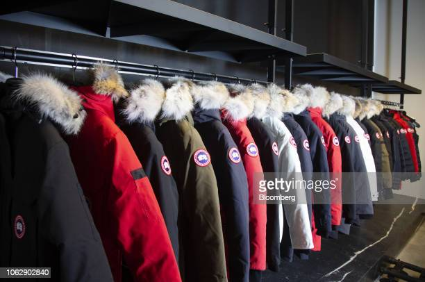 Parkas hang on display at the new Canada Goose Holdings Inc store in Montreal Quebec Canada on Thursday Nov 15 2018 Canada Goose is adding frigid...