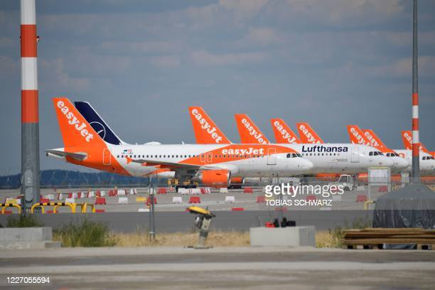 Parked aircrafts operated by Easyjet are pictured from the construction site of Berlin Brandenburg Airport Schoenefeld Airport near Berlin during a...