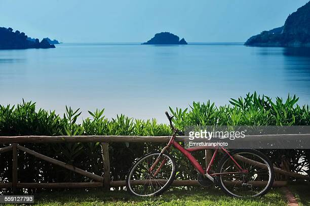 parked bike & island at the background - emreturanphoto stock pictures, royalty-free photos & images