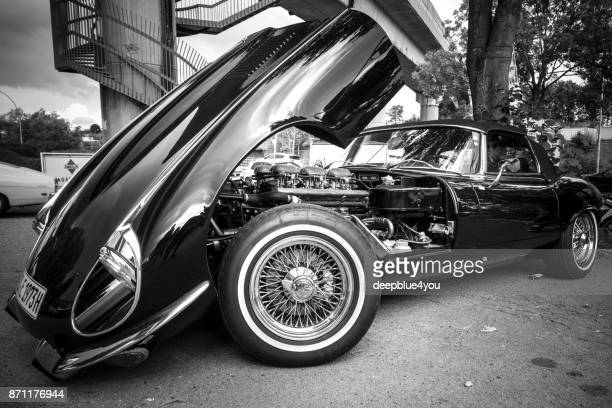 parked black jaguar with open motorhood in hamburg, germany - jaguar e type stock photos and pictures