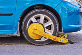 Parked car with an immobilizer tire lock of illegally