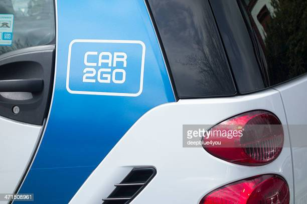 """parked """"car2go"""" vehicle in hamburg - daimler ag stock photos and pictures"""