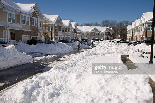 CONTENT] Parked cars and houses covered in thick snow after blizzard