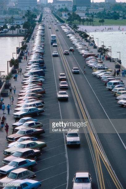 Parked Cars and Pedestrians on a Busy Bridge