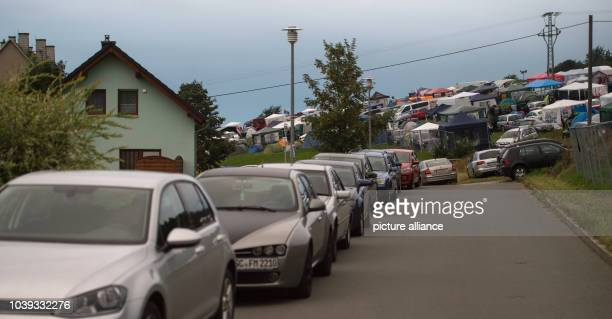 Parked cars and tents at the Electronic music festival 'SonneMondSterne' in SaalburgEbersdorf Germany 12 August 2016 PHOTO SOPHIA KEMBOWSKI/dpa |...