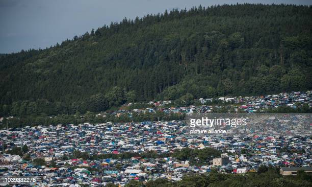 Parked cars and tents at the Electronic music festival 'SonneMondSterne' in SaalburgEbersdorf Germany 14 August 2016 PHOTO SOPHIA KEMBOWSKI/dpa |...