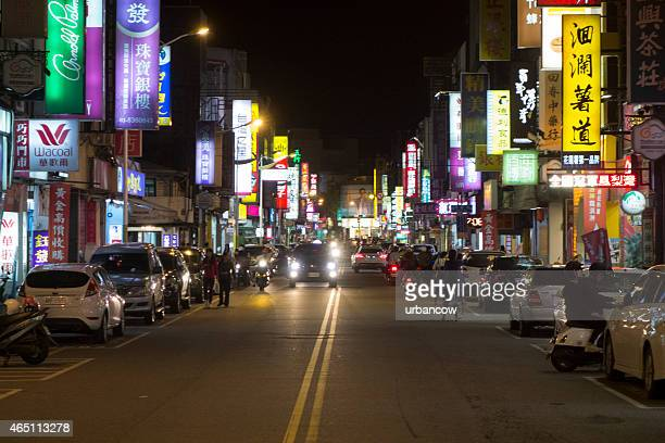 parked cars and traffic, shopping street at night, hualien, taiwan - hualien county stock pictures, royalty-free photos & images