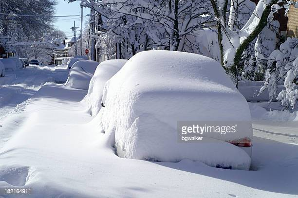 parked cars covered with snow in blizzard on city street - deep snow stock pictures, royalty-free photos & images