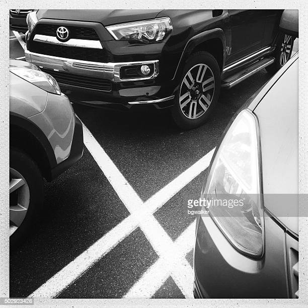 parked cars in lot with lines - toyota motor co stock pictures, royalty-free photos & images