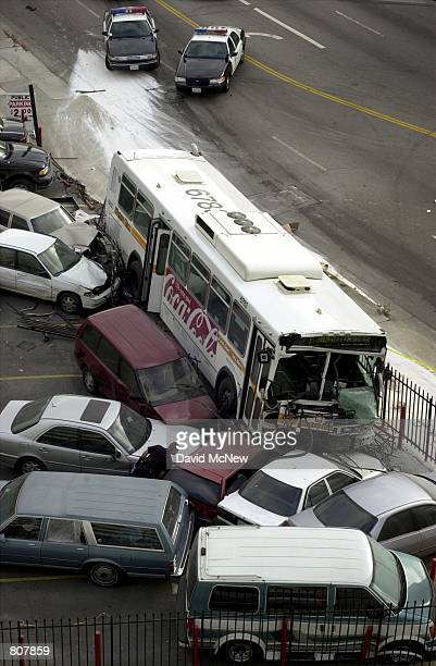 Parked cars lie in disarray after the crash of a Metropolitan Transit Authority bus that was hijacked by a gunman May 2 2001 in Los Angeles CA The...
