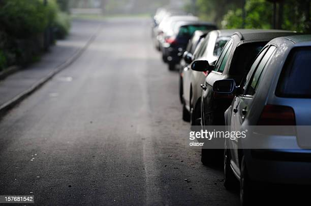 parked cars on street - curb stock pictures, royalty-free photos & images