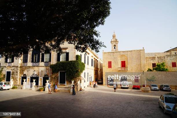 Parked Cars, people and Historic Bastion Square, Mdina, Malta