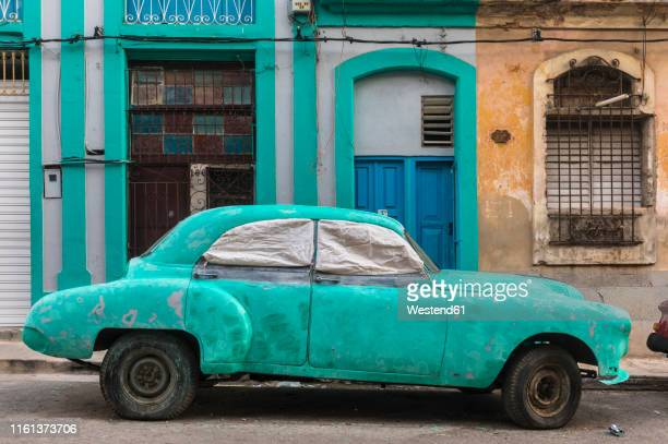 parked damaged vintage car, havana, cuba - obsolete stock pictures, royalty-free photos & images